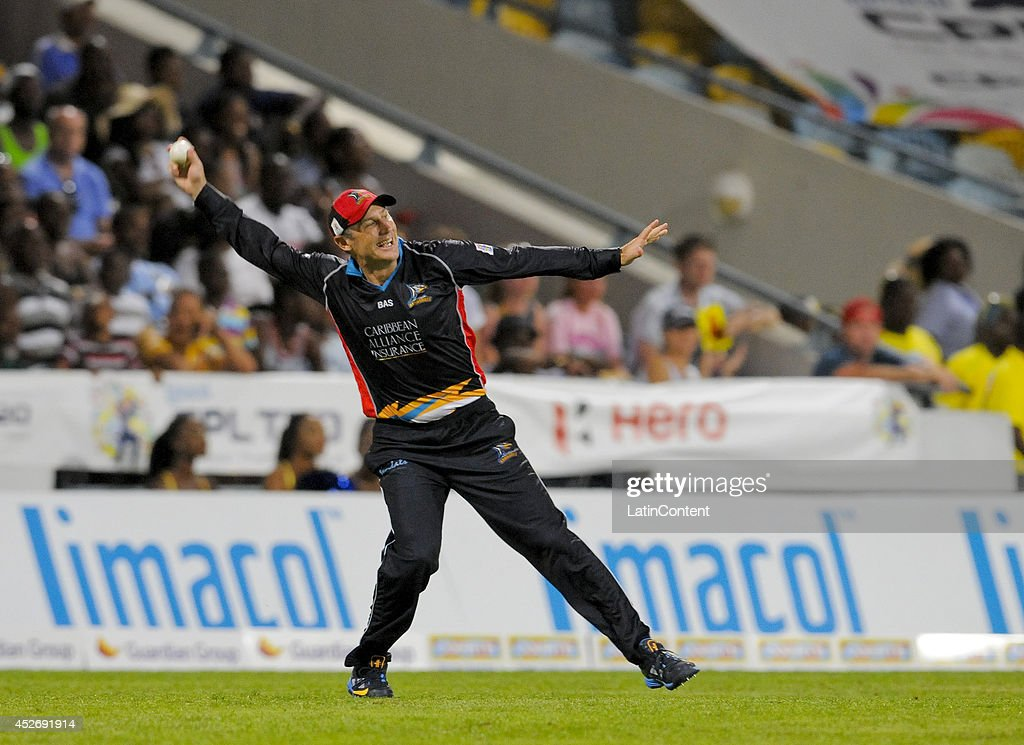 David Hussey of Antigua Hawksbills celebrates catching Kieron Pollard of Barbados Tridents during a match between Barbados Tridents and Antigua Hawksbills as part of the week 3 of Caribbean Premier League 2014 at Kensington Oval on July 25, 2014 in Bridgetown, Barbados.