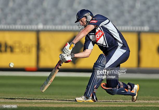 David Hussey of Bushrangers bats and hits a six on his way to a century during the Ryobi One Day Cup match between Victorian Bushrangers and the...