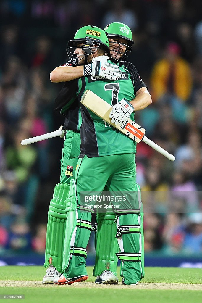 David Hussey of the Stars celebrates with team mate Tom Triffitt after Triffitt hit the winning runs during the Big Bash League match between the Sydney Sixers and the Melbourne Stars at Sydney Cricket Ground on December 27, 2015 in Sydney, Australia.