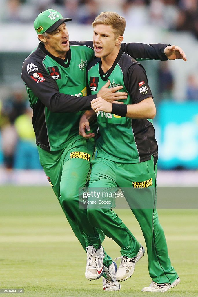 David Hussey of the Stars (L) hugs Adam Zampa of the Stars after he took the wicket of Chris Lynn of the Heat during the Big Bash League match between the Melbourne Stars and the Brisbane Heat at Melbourne Cricket Ground on January 14, 2016 in Melbourne, Australia.