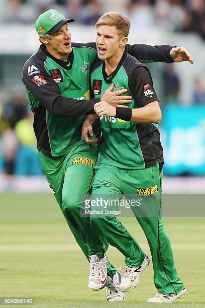 David Hussey of the Stars hugs Adam Zampa of the Stars after he took the wicket of Chris Lynn of the Heat during the Big Bash League match between...