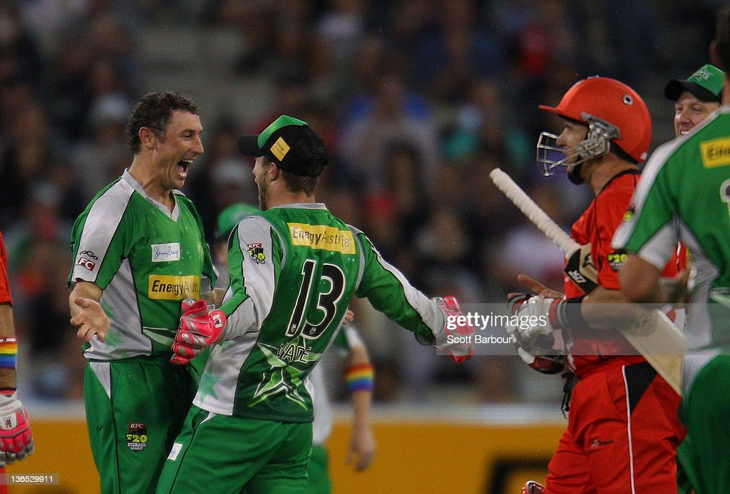 David Hussey of the Stars is congratulated by his team mates after dismissing Brad Hodge of the Renegades during the T20 Big Bash League match between the Melbourne Stars and the Melbourne Renegades at the Melbourne Cricket Ground on January 7, 2012 in Melbourne, Australia.
