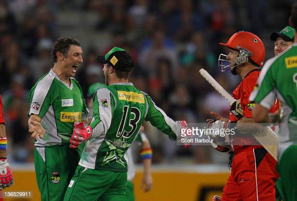 David Hussey of the Stars is congratulated by his team mates after dismissing Brad Hodge of the Renegades during the T20 Big Bash League match...