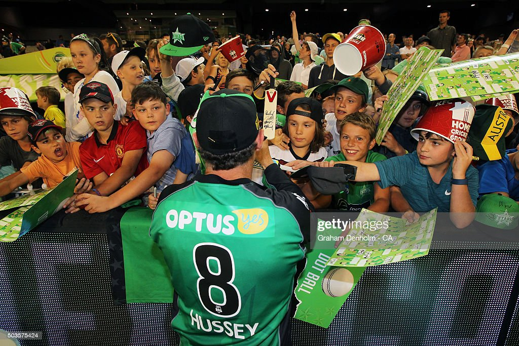 David Hussey of the Stars signs his autograph for fans following the Big Bash League match between the Melbourne Stars and the Hobart Hurricanes at Melbourne Cricket Ground on January 6, 2016 in Melbourne, Australia.