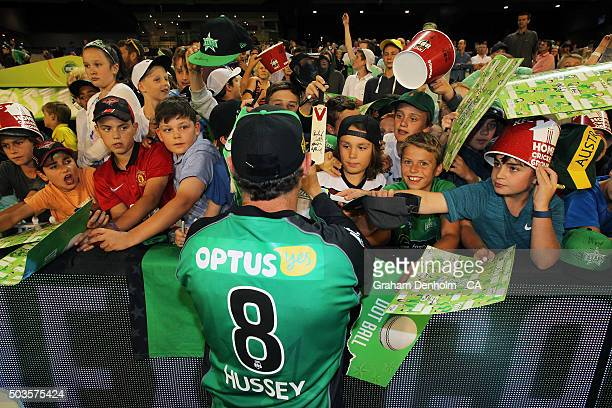 David Hussey of the Stars signs his autograph for fans following the Big Bash League match between the Melbourne Stars and the Hobart Hurricanes at...