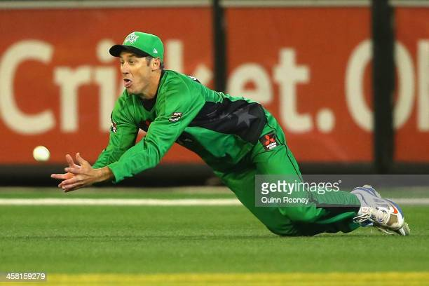 David Hussey of the Stars takes a catch to dismiss Aaron Finch of the Renegades during the Big Bash League match between the Melbourne Stars and the...