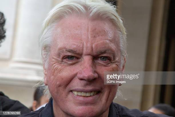 David Icke takes part during the demonstration. Protesters demonstrate against the wearing of face masks as the government proposes vaccines and...