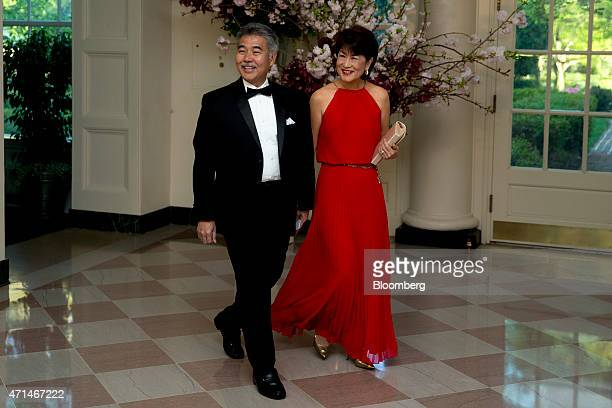 David Ige governor of Hawaii left and Dawn Ige arrive at a state dinner hosted by US President Barack Obama and US First Lady Michelle Obama in honor...