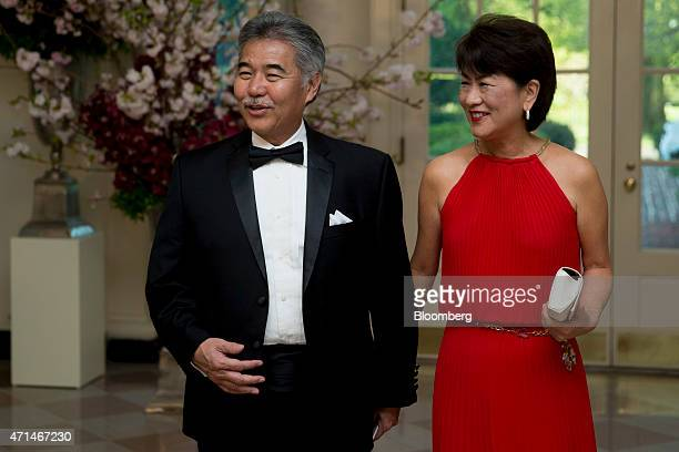 David Ige governor of Hawaii left and Dawn Ige speak to the media as they arrive at a state dinner hosted by US President Barack Obama and US First...