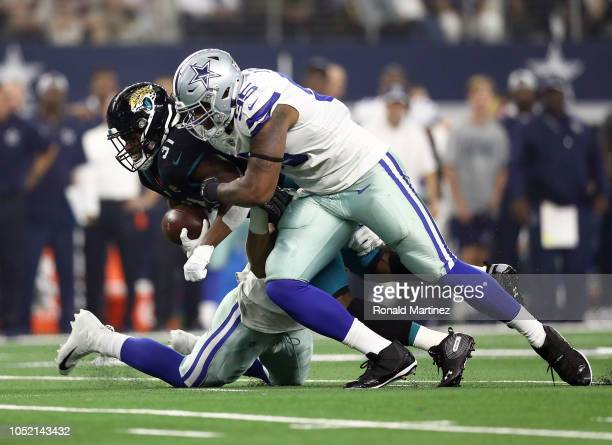 David Irving of the Dallas Cowboys tackles Jamaal Charles of the Jacksonville Jaguars in the second quarter of a game at ATT Stadium on October 14...