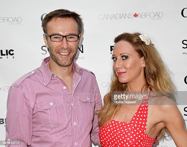 David Ivkovic and Renee Percy attend the Canada Day party in LA on the Sunset Strip on July 1 2014 in West Hollywood California