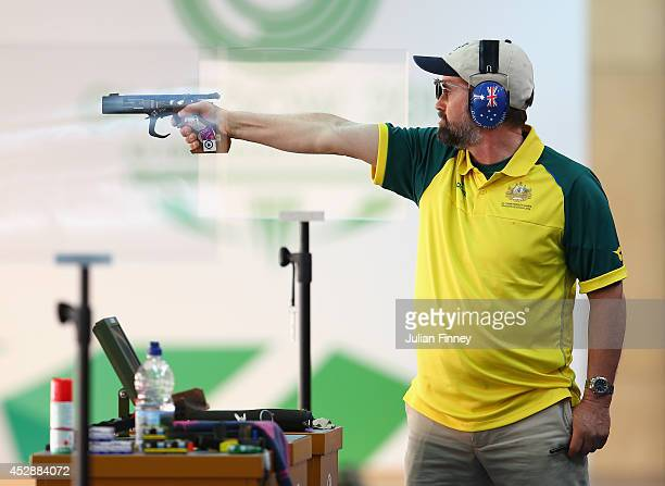David J Chapman of Australia in action in the 25m Rapid Fire Pistol Shooting event at Barry Buddon Shooting Centre during day six of the Glasgow 2014...