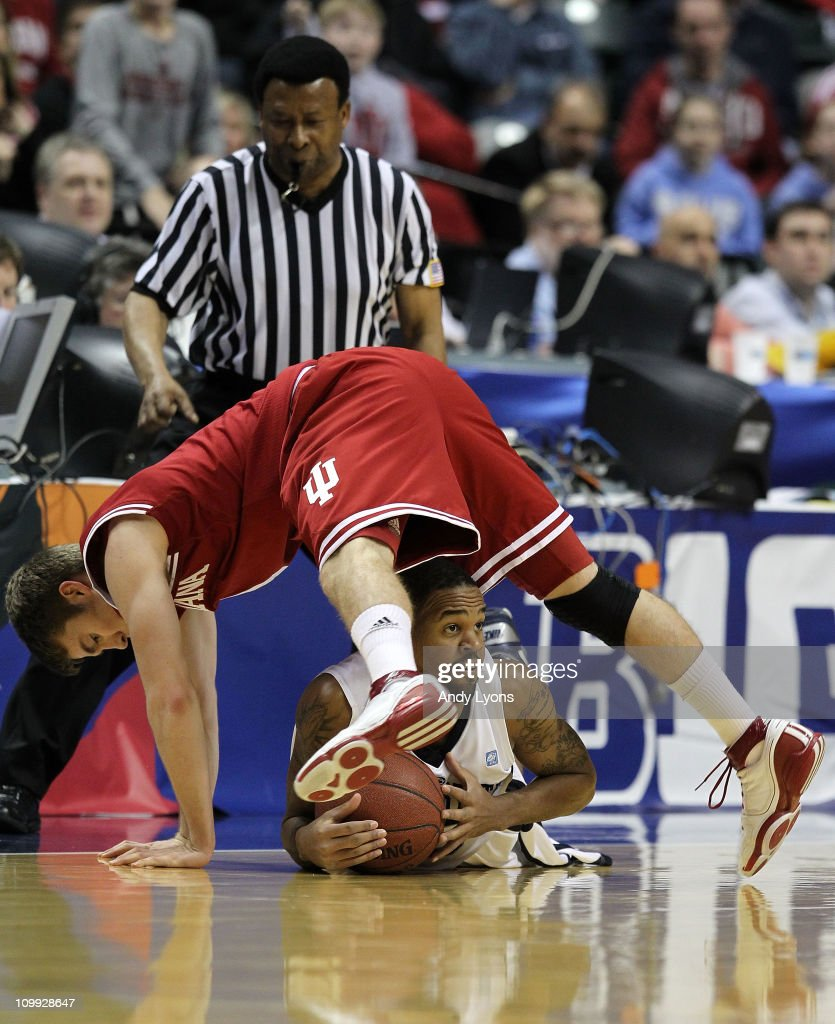 David Jackson #15 of the Penn State Nittany Lions fights for a loose ball against Jordan Hulls #1 of the Indiana Hoosiers during the first round of the 2011 Big Ten Men's Basketball Tournament at Conseco Fieldhouse on March 10, 2011 in Indianapolis, Indiana.