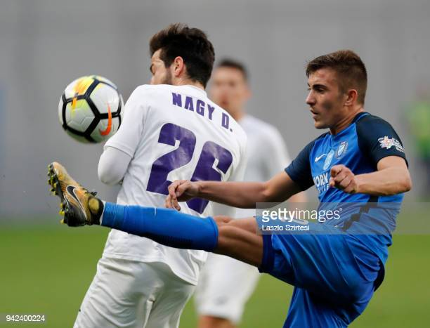 David Jakab of MTK Budapest wins the ball from Daniel Nagy of Ujpest FC during the Hungarian Cup Quarter Final 2nd Leg match between MTK Budapest and...