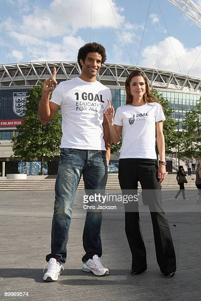 David James and Queen Rania Al Abdullah of Jordan pose for a photograph at the 1 Goal Education for All photocall at Wembley Stadium on August 20...