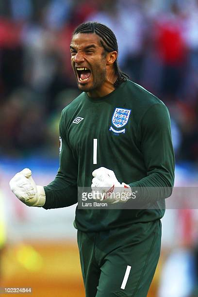 David James of England celebrates the opening goal by Jermain Defoe during the 2010 FIFA World Cup South Africa Group C match between Slovenia and...