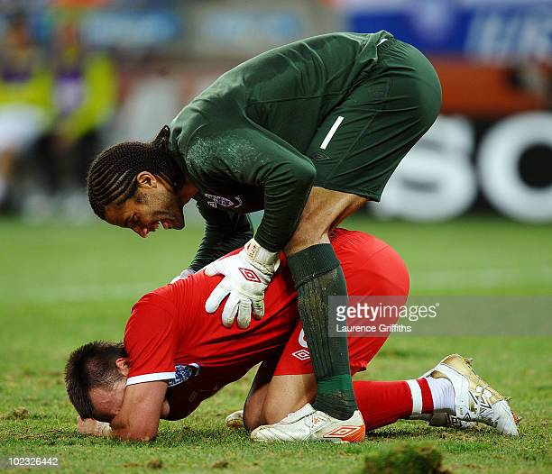 David James of England checks on team mate John Terry during the 2010 FIFA World Cup South Africa Group C match between Slovenia and England at the...