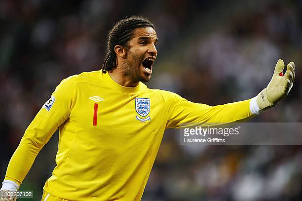 David James of England directs his defence during the 2010 FIFA World Cup South Africa Group C match between England and Algeria at Green Point...