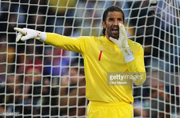 David James of England directs his defence during the 2010 FIFA World Cup South Africa Round of Sixteen match between Germany and England at Free...