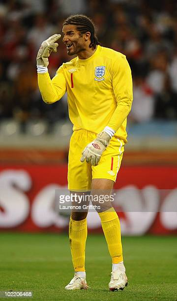 David James of England directs his defence to focus during the 2010 FIFA World Cup South Africa Group C match between England and Algeria at Green...