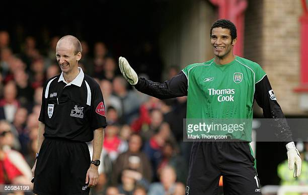 David James of Manchester City has a laugh with referee Mike Riley after Robert Pires misses a penalty during the Barclays Premiership match between...