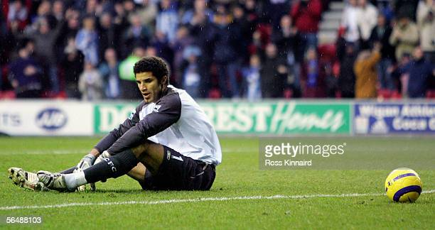 David James of Manchester City is beaten by Jason Roberts during the Barclays Premiership match between Wigan Athletic and Manchester City at the JJB...