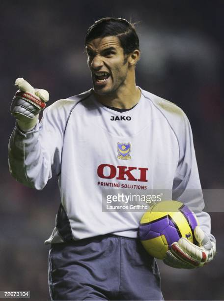 David James of Portsmouth jokes with a Liverpool Fan about his new hair style during the Barclays Premiership match between Liverpool and Portsmouth...