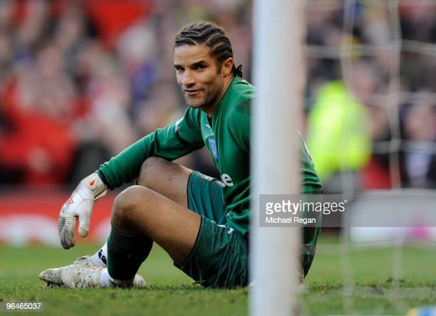 David James of Portsmouth looks dejected after conceding the 2nd goal during the Barclays Premier League match between Manchester United and...