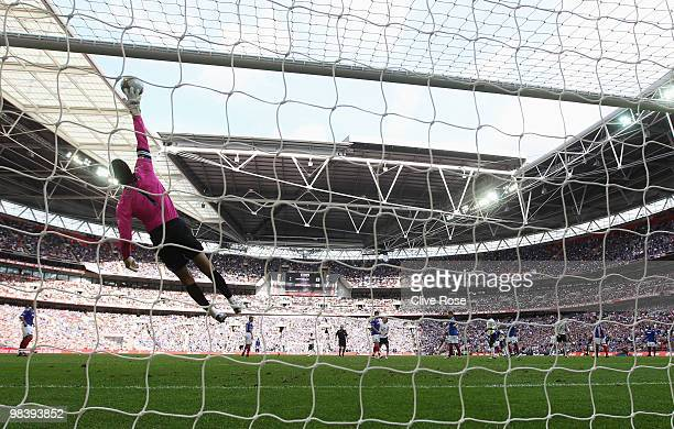David James of Portsmouth saves the shot during the FA Cup sponsored by EON Semi Final match between Tottenham Hotspur and Portsmouth at Wembley...