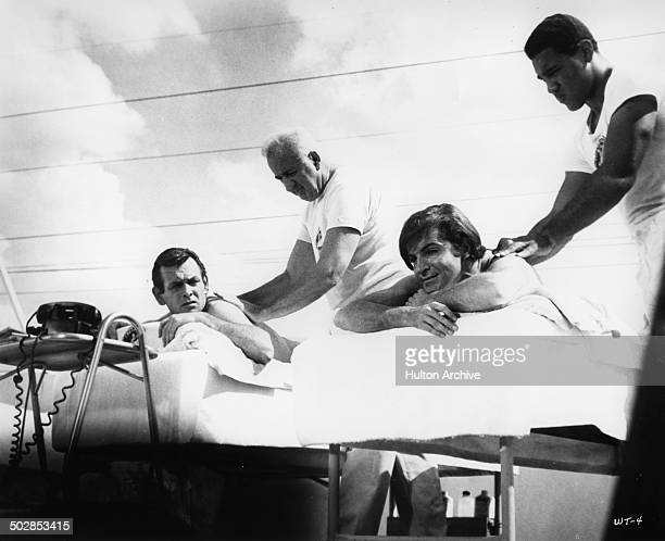 David Janssen and Robert Drivas get father and son massages in a scene for the United Artist movie Where It's At circa 1968