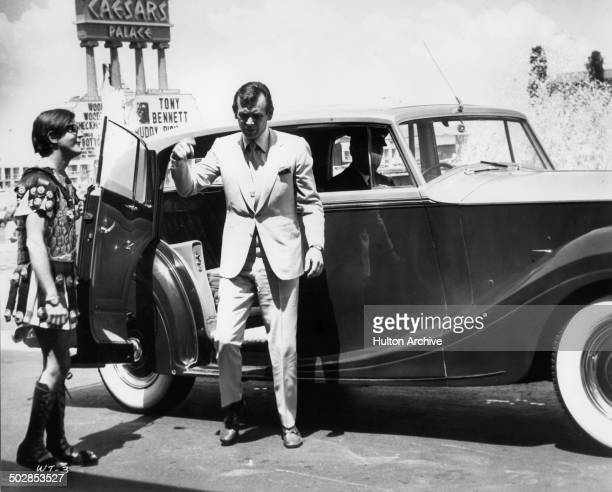 David Janssen gets out of his Rolls Royce in a scene for the United Artist movie Where It's At circa 1968