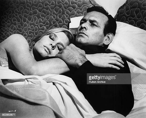 David Janssen lays in bed with Rosemary Forsyth in a scene for the United Artist movie Where It's At circa 1968