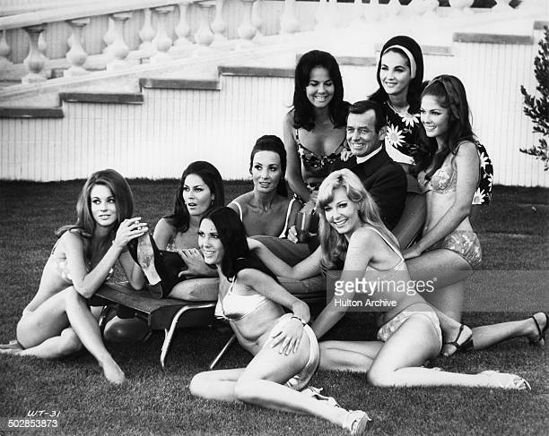 David Janssen poses with beautiful girls for the United Artist movie Where It's At circa 1968