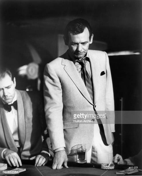 David Janssen puts down his cards in a scene for the United Artist movie Where It's At circa 1968