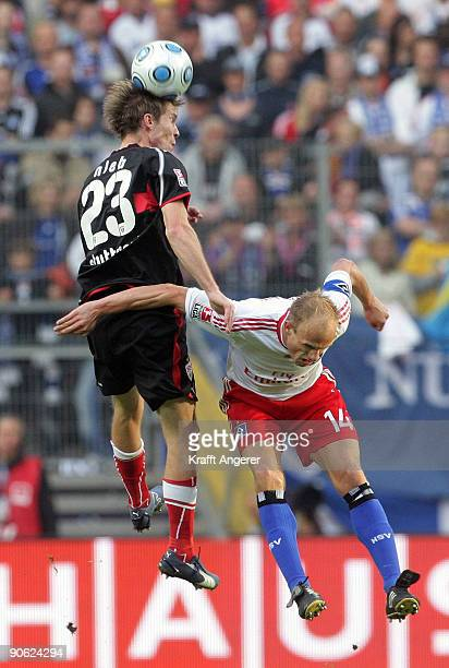 David Jarolim of Hamburg and Aliaksandr Hleb jump for a header of Stuttgart during the Bundesliga match between Hamburger SV and VfB Stuttgart at HSH...