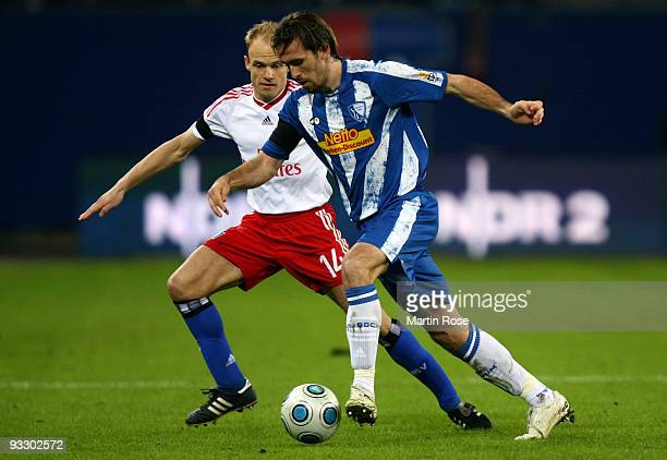David Jarolim of Hamburg and Christian Fuchs of Bochum battle for the ball during the Bundesliga match between Hamburger SV and VfL Bochum at the HSH...
