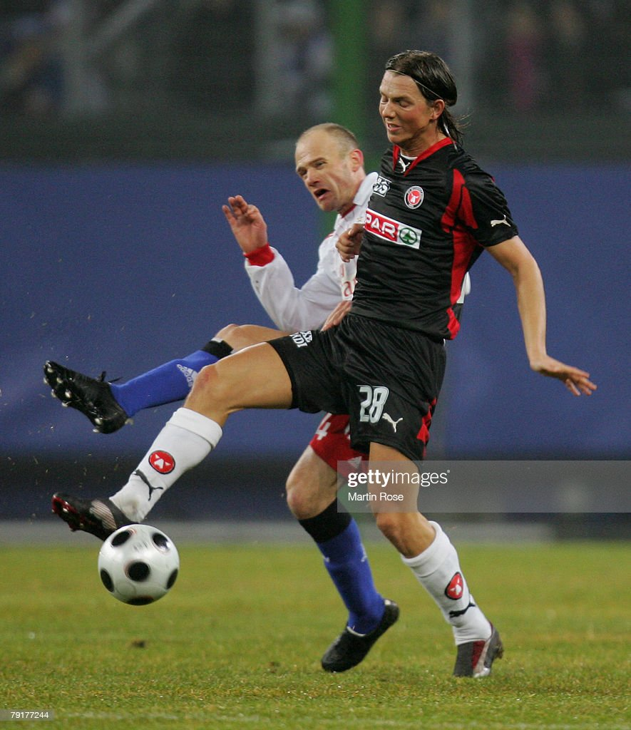 David Jarolim (L) of Hamburg and Dennis Flinta (R) of Midtjyland compete for the ball during the friendly match between Hamburger SV and FC Midtjyland at the HSH Nordbank Arena on January 23, 2008 in Hamburg, Germany.