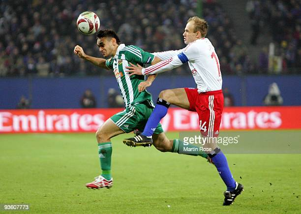 David Jarolim of Hamburg and Veli Kavlak of Wien compete for the ball during the UEFA Europa League Group C match between Hamburger SV and SK Rapid...