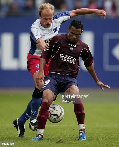 David Jarolim of Hamburg attacks Maciel Cunha of Leiria during the UEFA Intertoto Cup third round match between Hamburger SV and DU Leiria at the AOL...