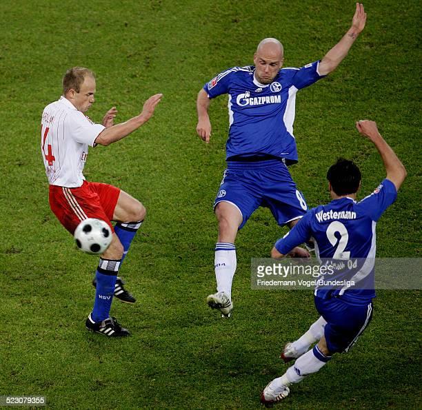David Jarolim of Hamburg challenges Fabian Ernst and Heiko Westermann of Schalke for the ball during the Bundesliga match between Hamburger SV and FC...