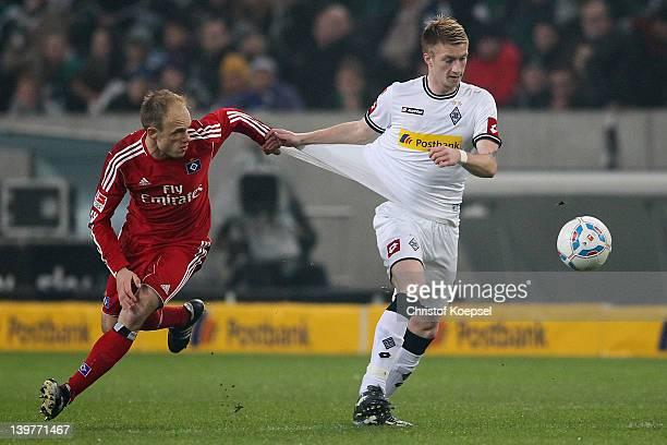 David Jarolim of Hamburg challenges Marco Reus of Moenchengladbach during the Bundesliga match between Borussia Moenchengladbach and Hamburger SV at...