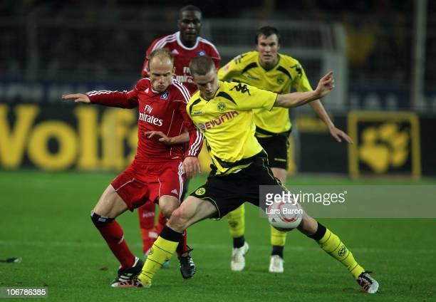 David Jarolim of Hamburg challenges Sven Bender of Dortmund during the Bundesliga match between Borussia Dortmund and Hamburger SV at Signal Iduna...