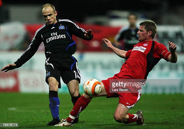 David Jarolim of Hamburg in action with Michael Lorenz of Essen during the DFB Cup Round of 16 match between RotWeiss Essen and Hamburger SV at...
