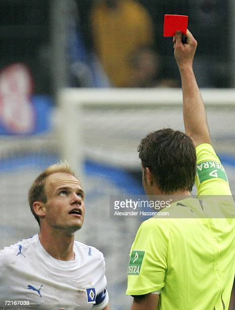 David Jarolim of Hamburg reacts after receiving the Red Card from referee Dr Felix Brych during the Bundesliga match between Hamburger SV and Schalke...