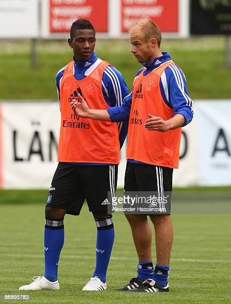 David Jarolim talks to his team mate Eljero Elia during a training session at day three of the Hamburger SV training camp on July 8, 2009 in...