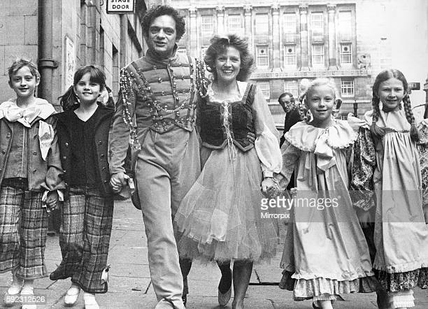 David Jason and Leah Bell who are in the pantomime Cinderella at the Theatre Royal Newcastle with four of the choldren from the Margaret Wade School...