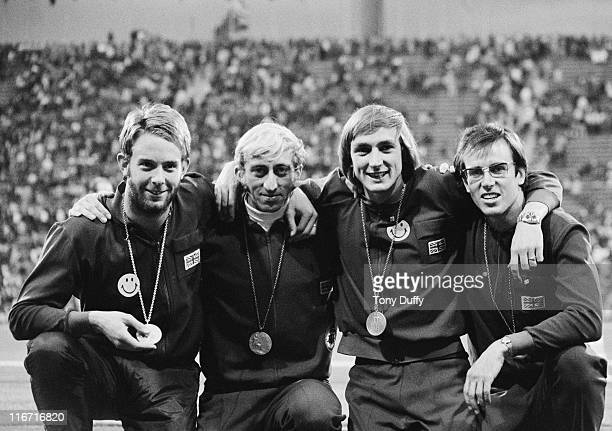 David Jenkins David Hemery Alan Pascoe and Martin Reynolds of Great Britain celebrate winning the silver medal in the Men's 4 x 400 Metres Relay...