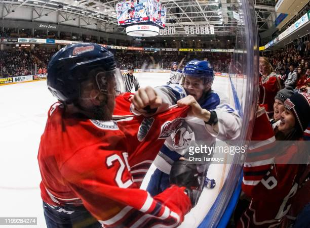 David Jesus of the Oshawa Generals fights Brett Jacklin of he Sudbury Wolves in the third period during an OHL game at the Tribute Communities Centre...