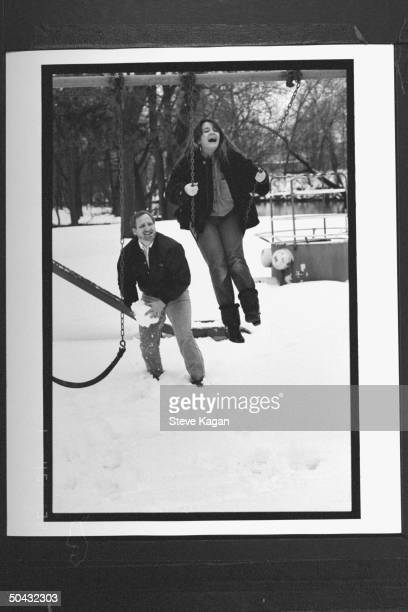 David Jewell pushing swing that his 12yrold daughter Kiri is perched in in yard at home Jewell fought for custody of Kiri won when it was discovered...