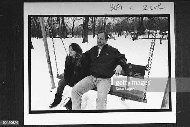 David Jewell sitting on swing w. His 12-yr-old daughter Kiri in snowy yard at home; Jewell fought for custody of Kiri & won when it was discovered...